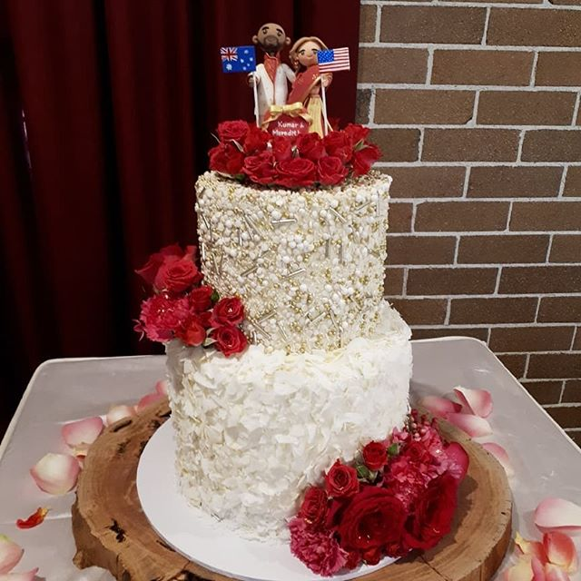 I loved designing this unique, fun and beautiful wedding cake for Kumar and Meredith! The bride love