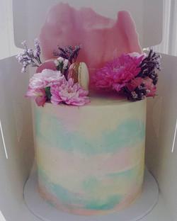 Close up of the top cake. Dark chocolate Mud cake with dark chocolate ganache underneath vanilla bea