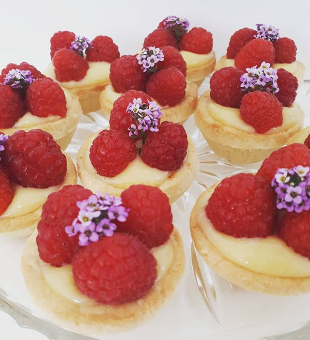 Passionfruit curd and raspberry tarts. #highteacatering #hightea #cakesbyheidi.com
