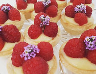 Passionfruit curd and raspberry tarts. #