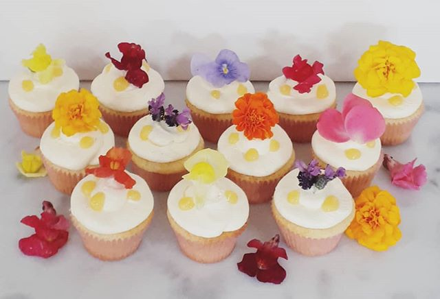 Edible flowers on lemon curd cupcakes
