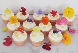 Edible flowers on lemon curd cupcakes