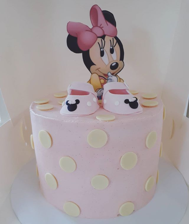 And finally the cake with a minnie mouse theme and cute little baby shoes Red velvet and vanilla bea