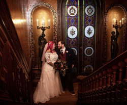 A romantic moment on the staircase landing