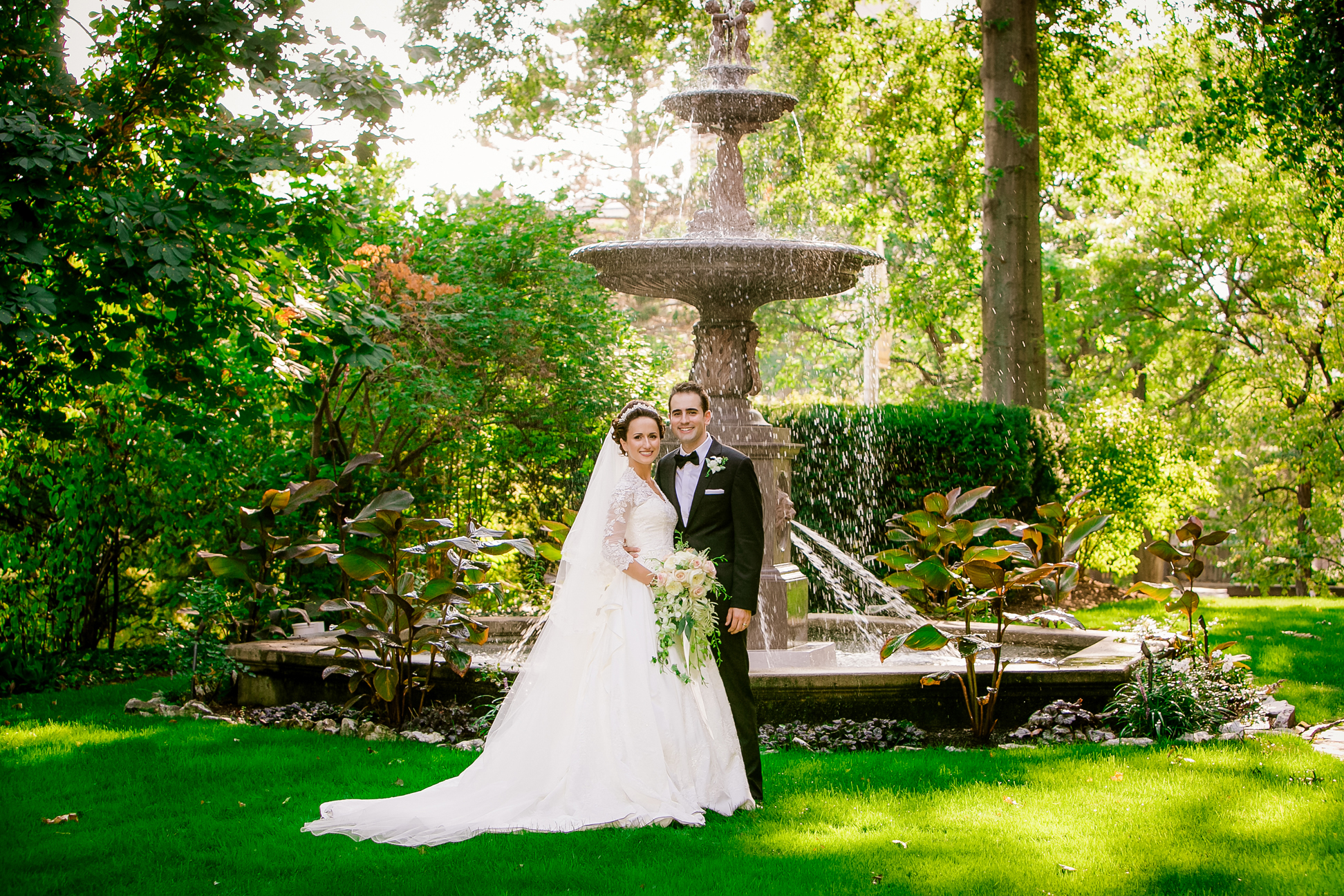 Bride and groom with the Lippitt House fountain