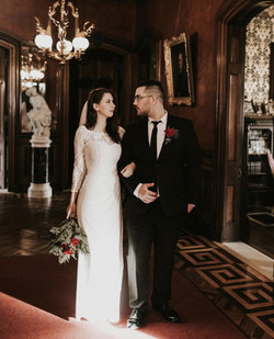 Bride and groom pause in the Lippitt House hall