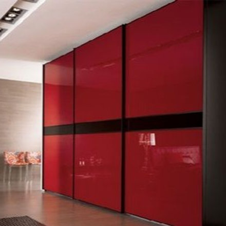 Sliding bedroom cupboards with a red sleek colour