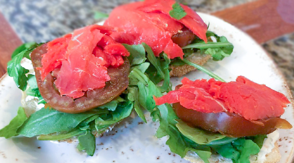 Smoked salmon sandwich is a recipe that has salmon and cream cheese. Enjoy this summer sandwich recipe with tomatoes, lettuce, and smoked salmon.