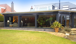 A large dark grey home extension.jpg