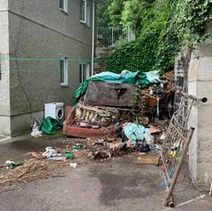 A big pile of house waste outside.jpg