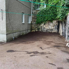 An empty driveway outside of a house.jpg