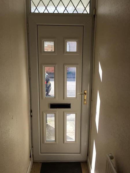 A white door inside a house.jpg