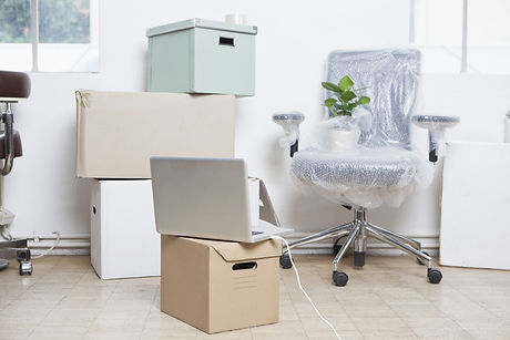 moving boxes and a computer chair.jpg