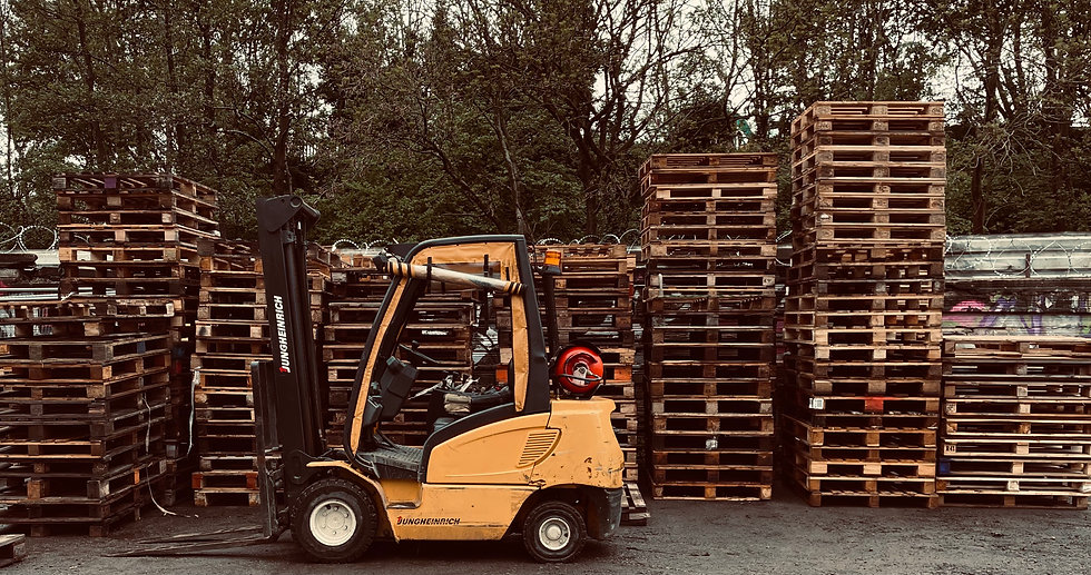 A fork lifter in front of pallets