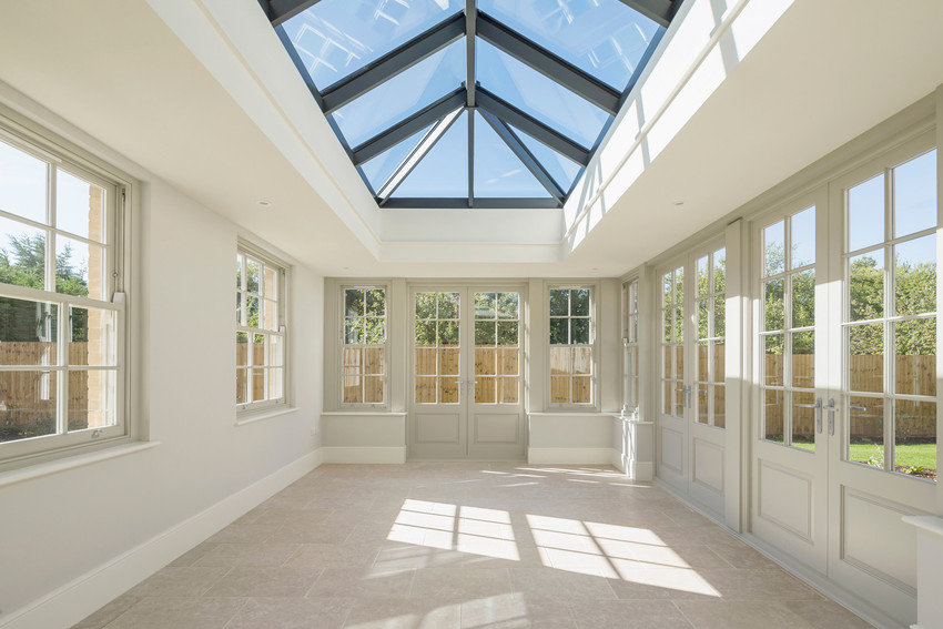 A large conservatory with a grey door.jp