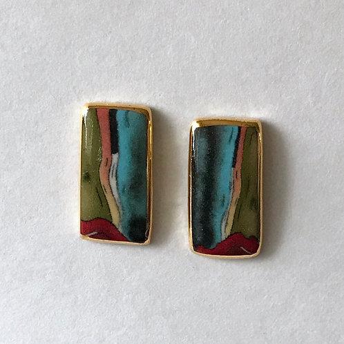 Japanese porcelain earrings edged in 24 carat gold.