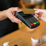 hands-with-payment-terminal-and-credit-c