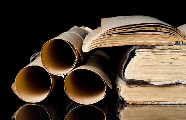 Many scrolls and old books on black.jpg