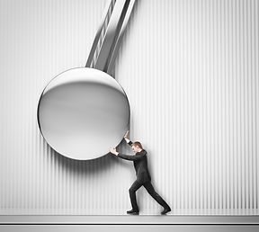 businessman pushing the pendulum.jpg