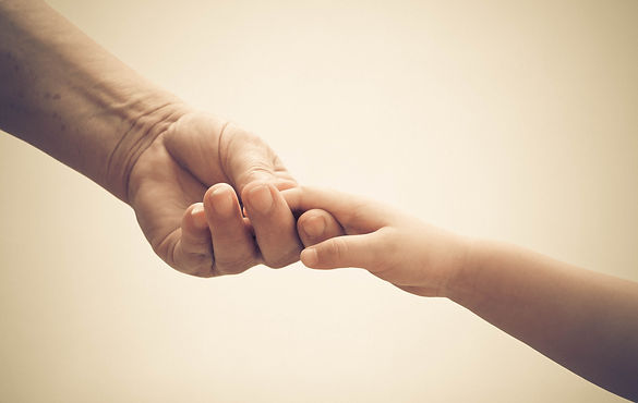 Old female hand holding young baby hand