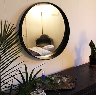 A reflection of a spa bed within a circular mirror.