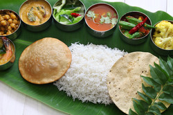 Canva - south indian meals on banana lea