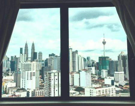 The view of of Kuala Lumpur Petronas Twin Tower (KLCC) and Kl Tower from a window directly which can only be seen from Utopia's Rooms