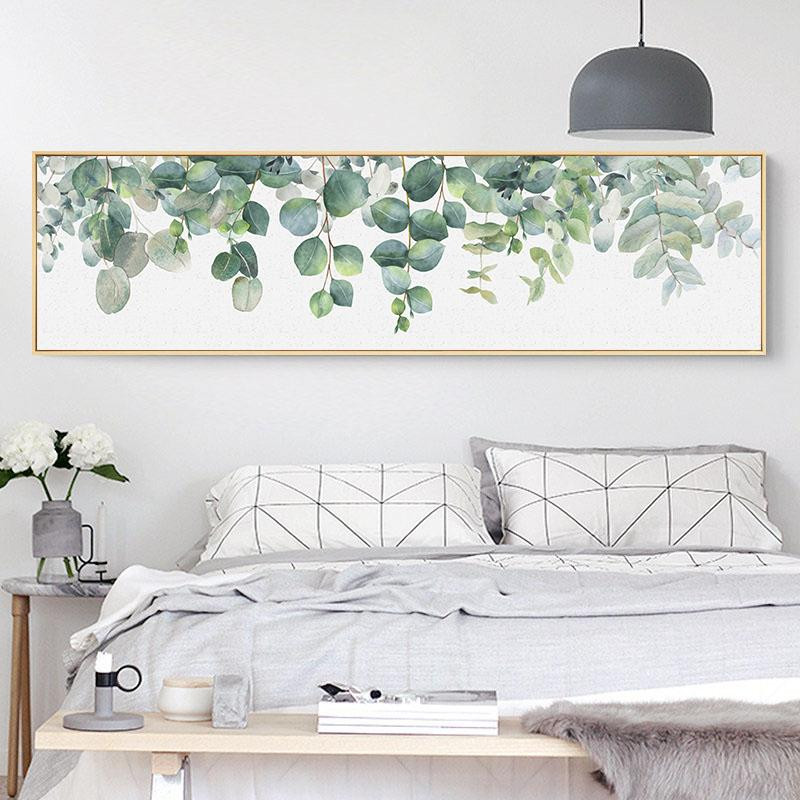 a well decorated bedroom with a picture frame of leaves