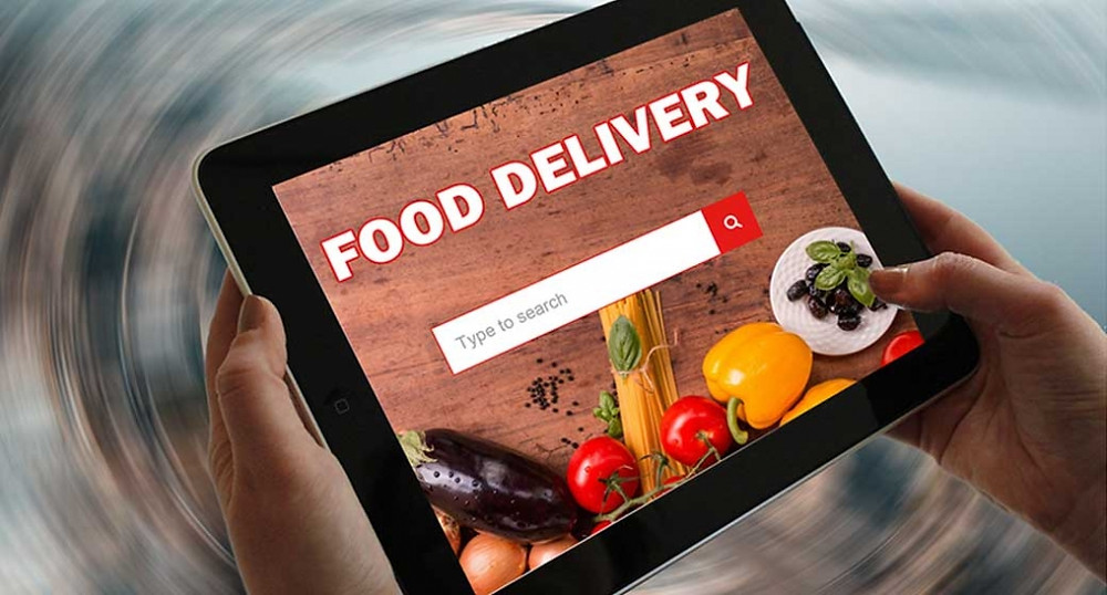 Tablet with a food delivery title