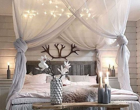 Pretty bedroom with fairy lights alongside simple minimalist deocrations.