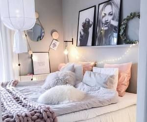 A well decorated bedroom with fairy lights
