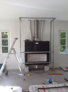 Installation d'un foyer à bois + distribution d'air chaud