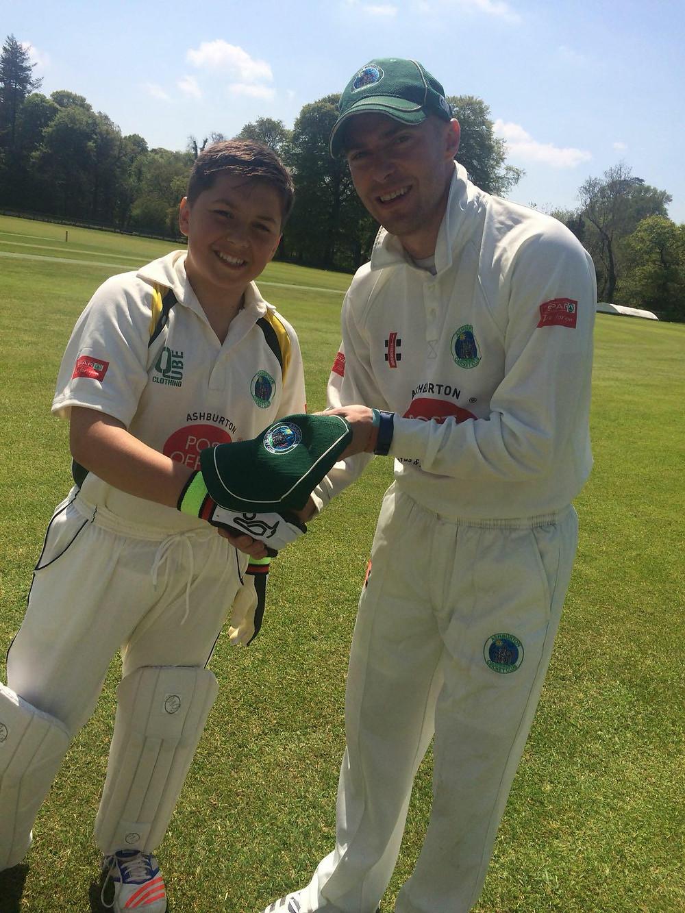 Tom Rush receives his 1st XI cap from skipper Ash Berry