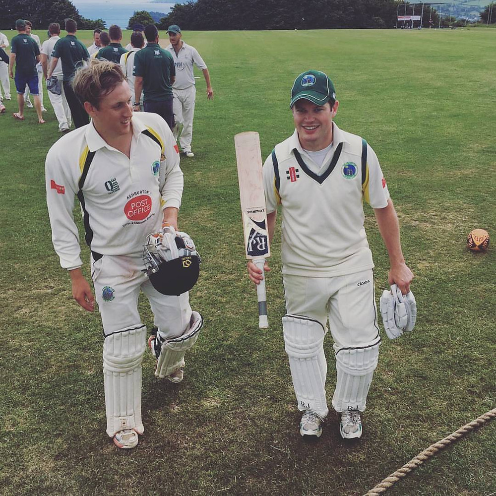Ash Harvey (right) and Lloyd White leave the field after their unbroken stand of 115