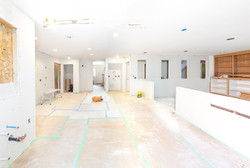 Drywall is hung in kitchen and family ro
