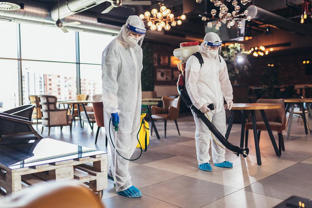 Professional workers in hazmat suits dis