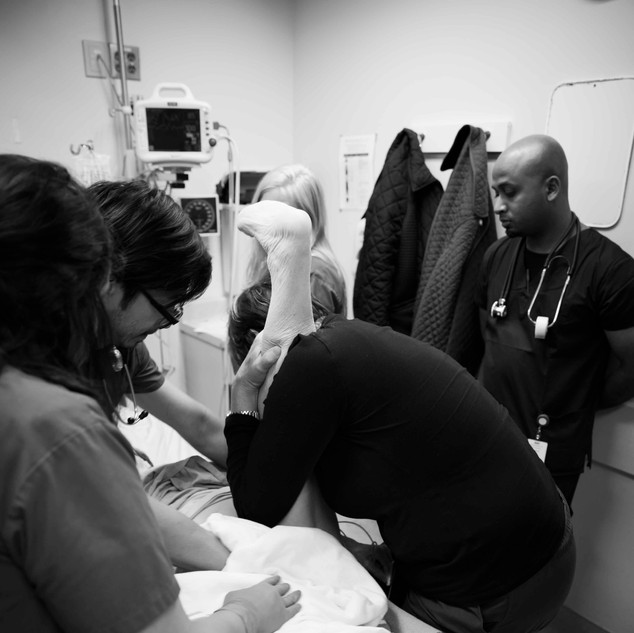 nurse practitioner Shirley Strachan-Jackman manipulates her patient's left hip back into place