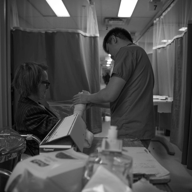 a plastic surgery resident tends to a patient's injured hand