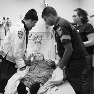paramedics Edward and Dilshan transport a patient with suspected hip dislocation