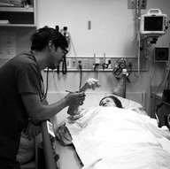 emergency doctor David Ng assesses patient for procedural sedation