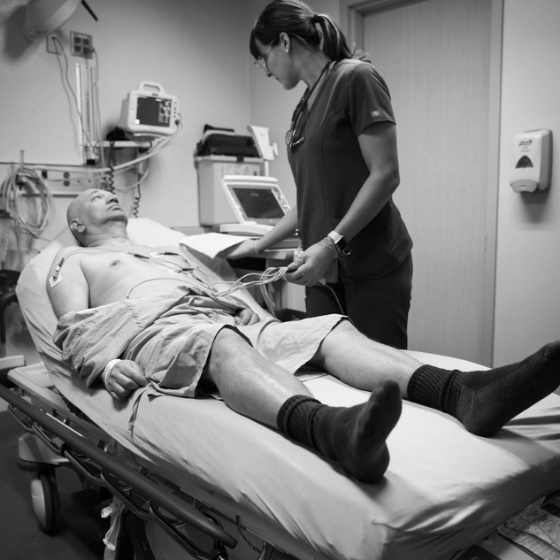 emergency nurse performs an ECG for chest pain assessment