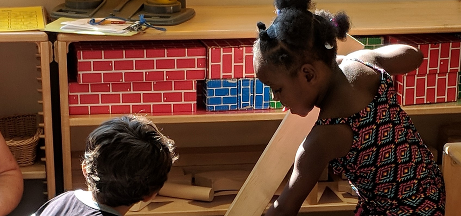 Boy and girl building with blocks