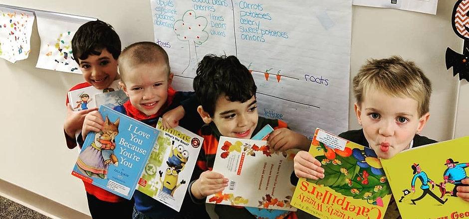 Boys holding books