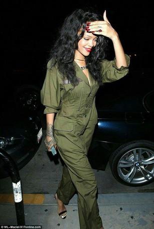 Rihanna wears a Khaki jumpsuit, walking the streets