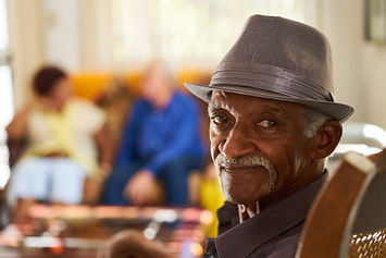 Portrait of elderly black man looking at
