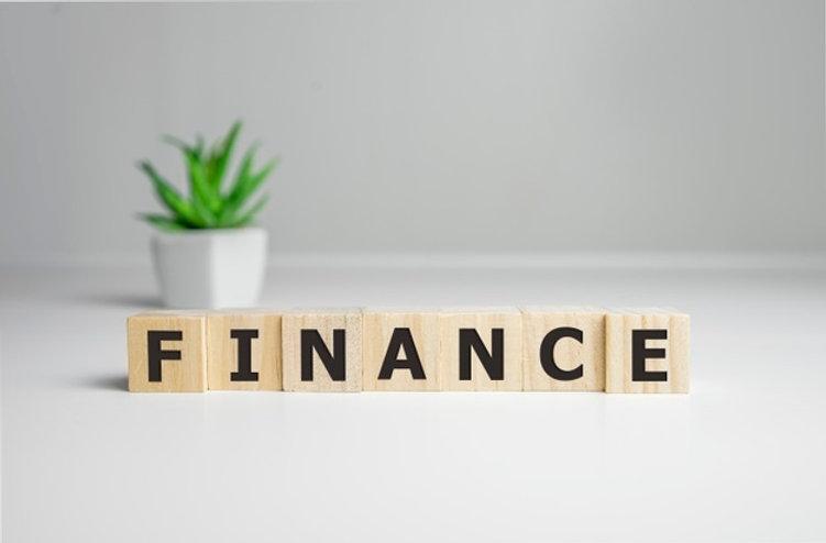 finance-word-written-wood-block-business