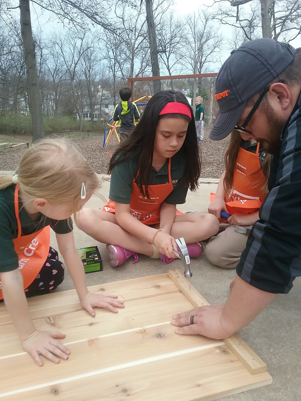 Students nail together garden box.