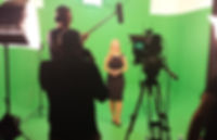 Photo of Sarah Rees doing green screen presenting