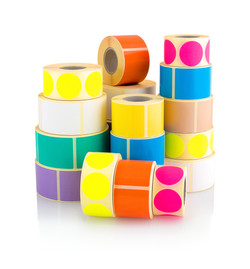 Colored label rolls isolated on white background with shadow reflection. Color reels of labels for p