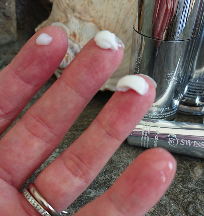 swiss clinic products on fingers
